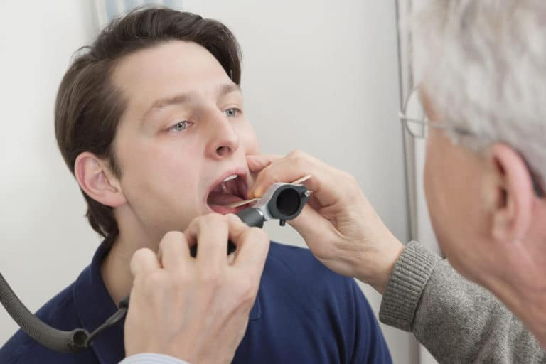 A patient having their throat examined by an otolaryng
