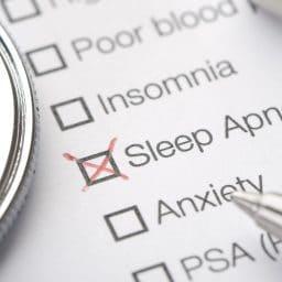Sleep apnea medical record chart close up with pen