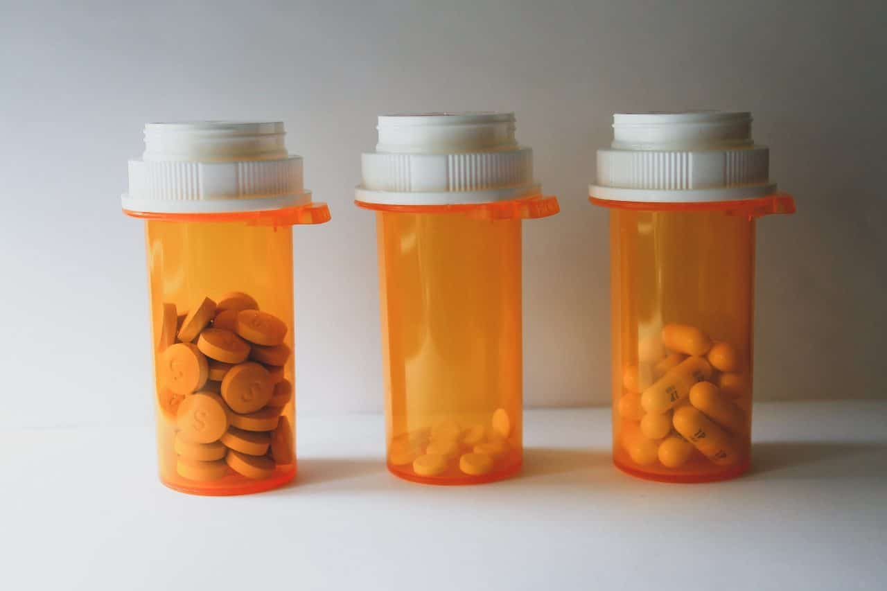 three orange pill bottles in a row