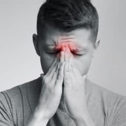 Man experiencing sinus pressure.